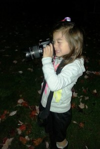 A little girl with a big camera!